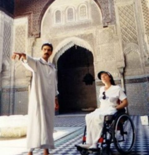 Tour guide with a girl on wheelchair