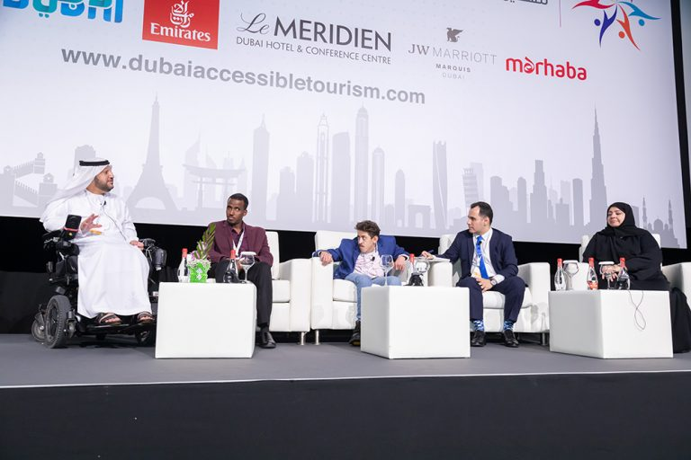 a group of speakers at the summit