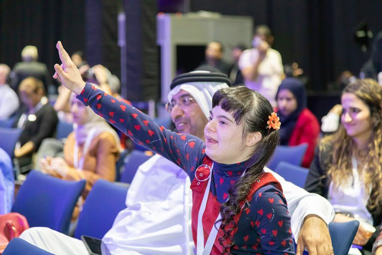 Happy young girl attending the 2019 summit