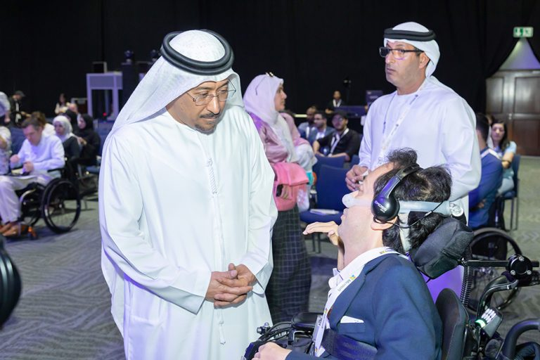 Dawood Al Hajri speaking to one of the attendees